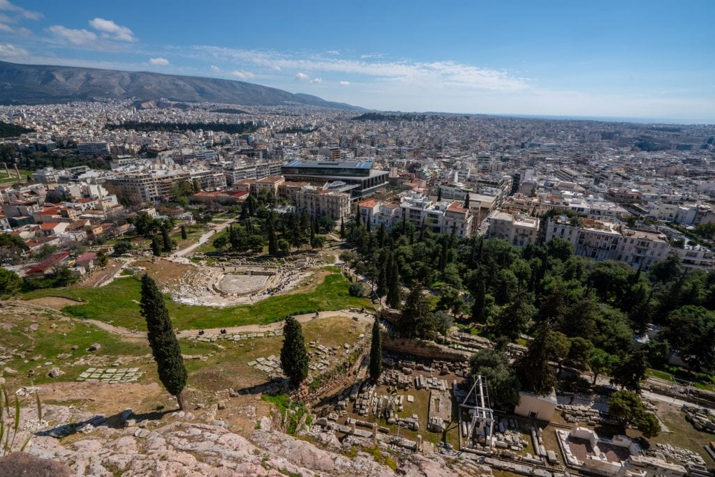 Looking down slopes of Acropolis, theater of Dionysus in distance, 2 day Athens itinerary