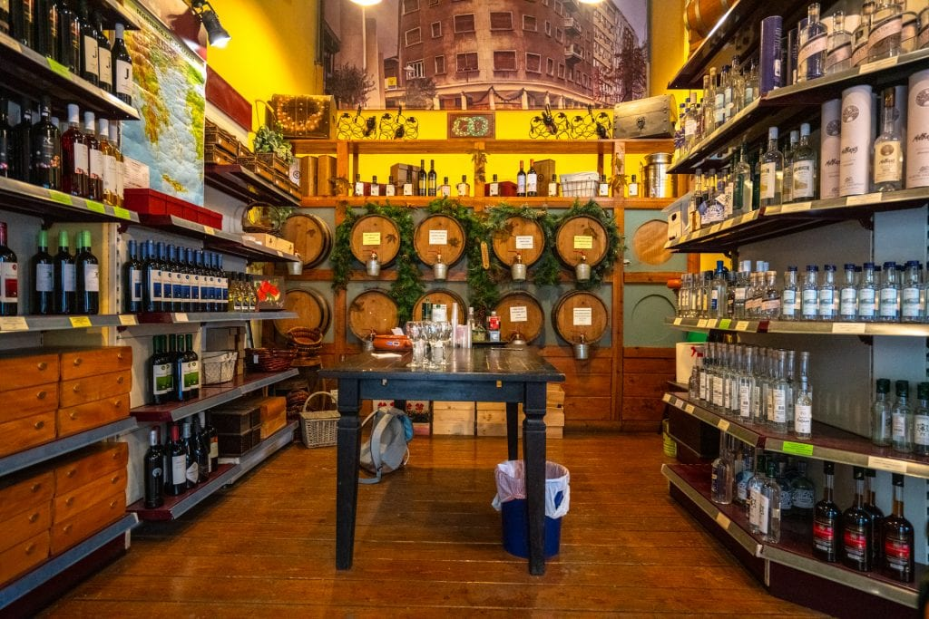 Overview of shop with wine barrels in Athens, Athens food tour