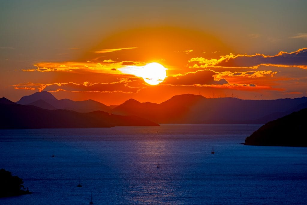 One Day Dubrovnik Itinerary: Sunset over Adriatic Sea with boats in front