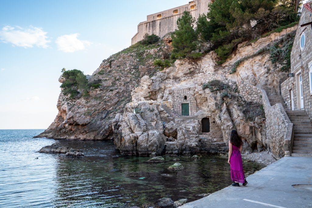 Fun Things to Do in Dubrovnik Croatia: Girl standing near West Harbour doors