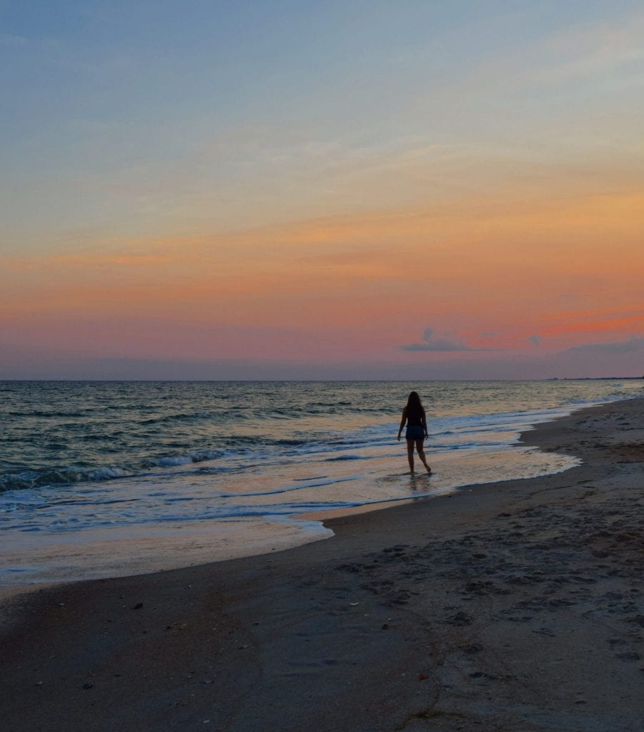What to Do in Beaufort NC: girl on beach at sunset