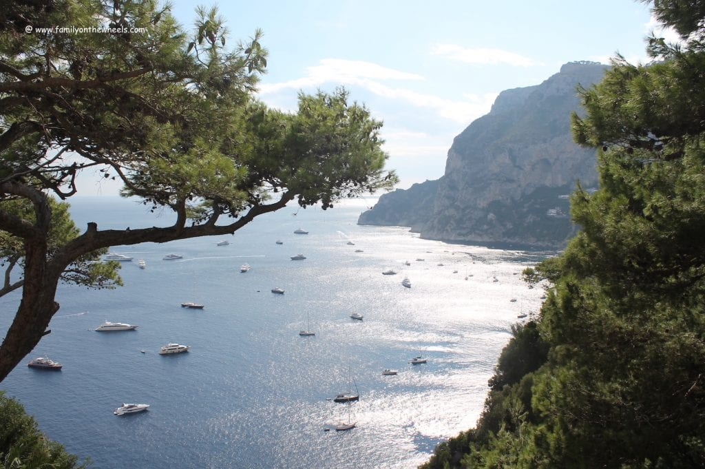 View of boats in the sea in Capri, one of the best beach towns in Italy