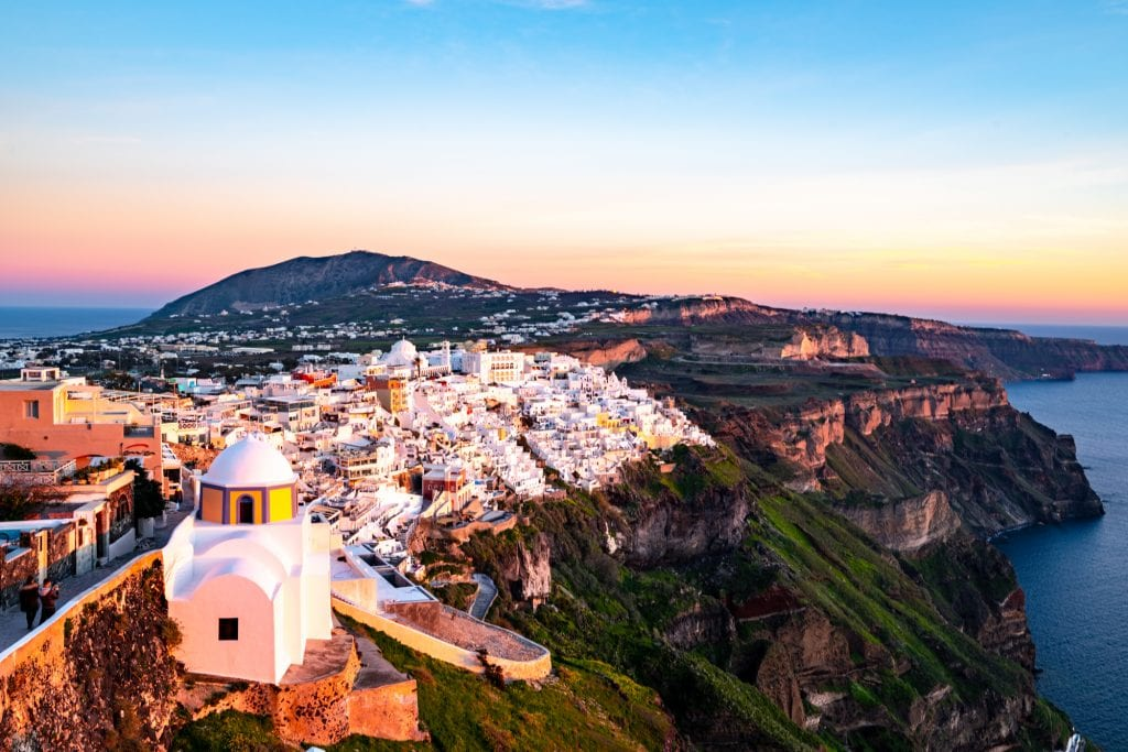 view of santorini village from above at sunset