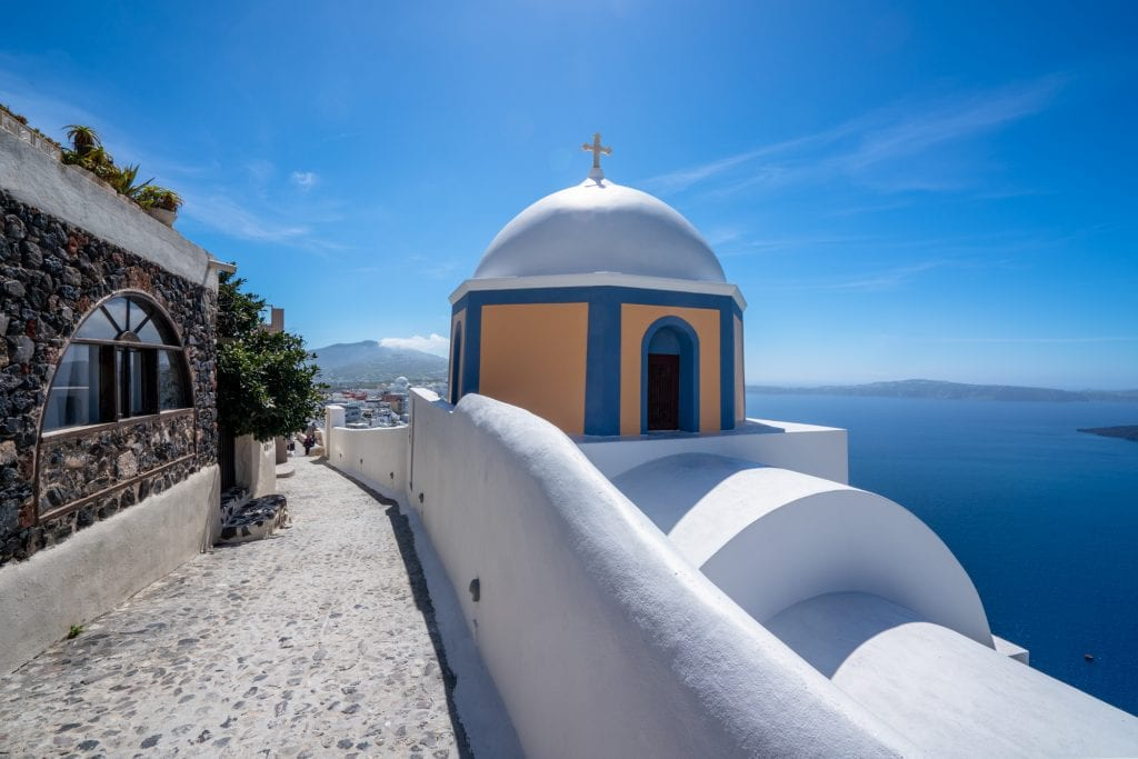 Peach and blue dome with trail on Santorini, 3 days in Santorini itinerary