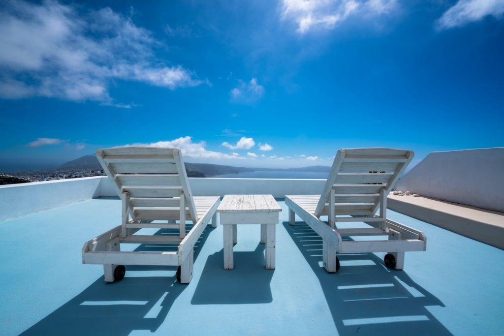 Sun chairs on blue rooftop in Santorini, 3 days in Santorini itinerary