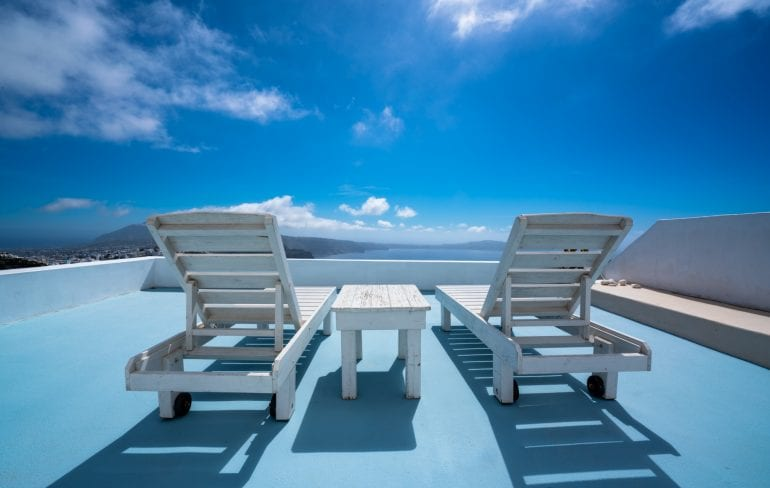 Sun chairs on blue rooftop in Santorini, Honeymoon in Santorini Itinerary