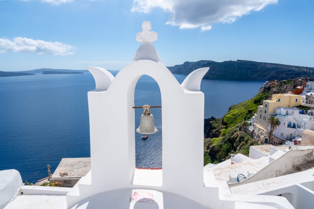View of white bell tower in Santorini, 3 day Santorini itinerary