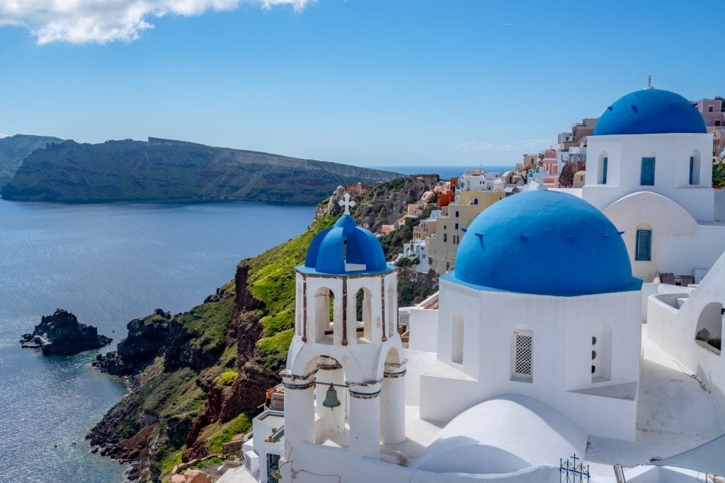 3 blue domes of Santorini--preparing dealing with putting together the right long flight essentials is definitely worth it to land somewhere like this!