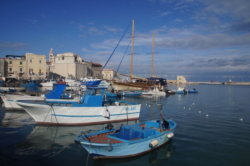 Boats on the water in Trani, Puglia, one of the best beach towns in Italy.