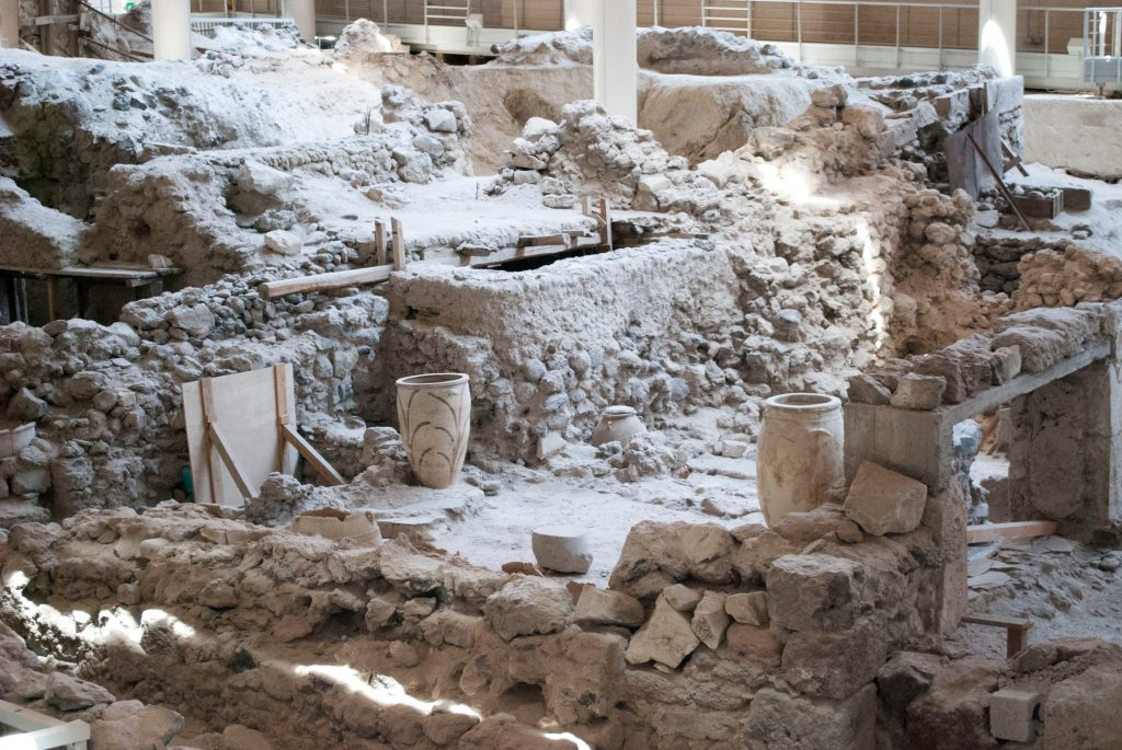 archaeological site akrotiri as seen during an itinerary santorini 3 days. pots are visible amongst the building ruins