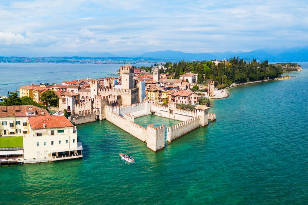 aerial view of sirmione italy with castle in the foreground surrounded by the sea