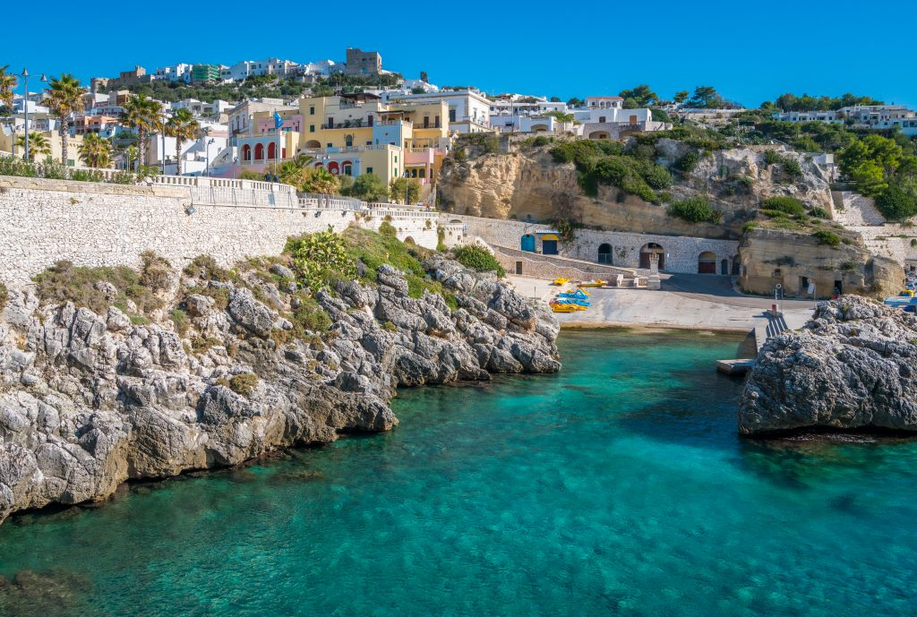 white town of castro puglia as seen from the water