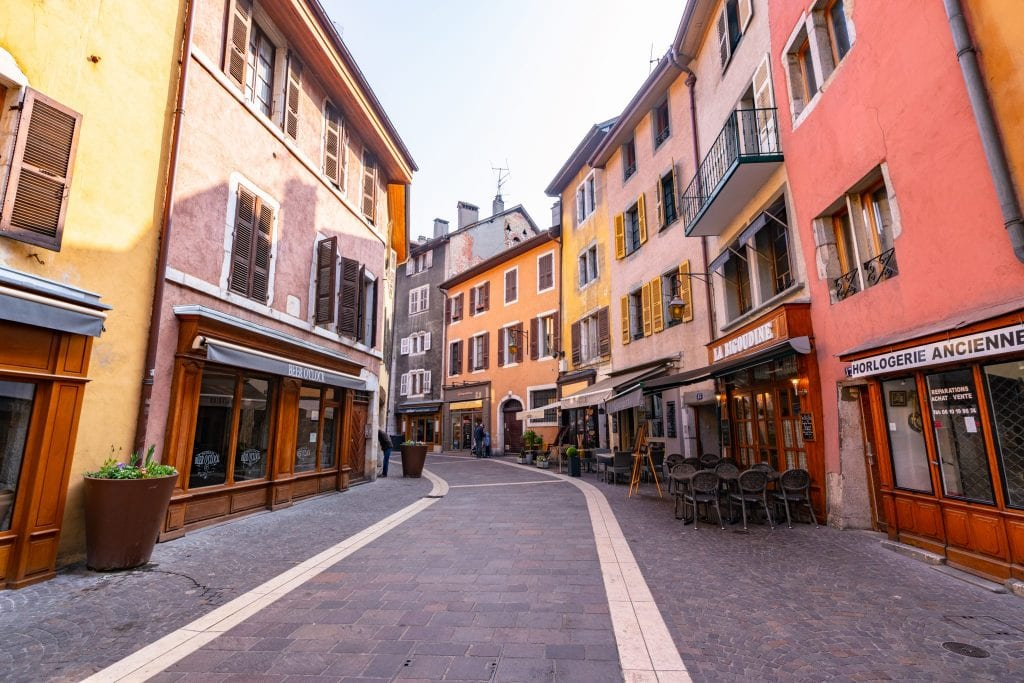 Pedestrian street lined with colorful buildings in Annecy