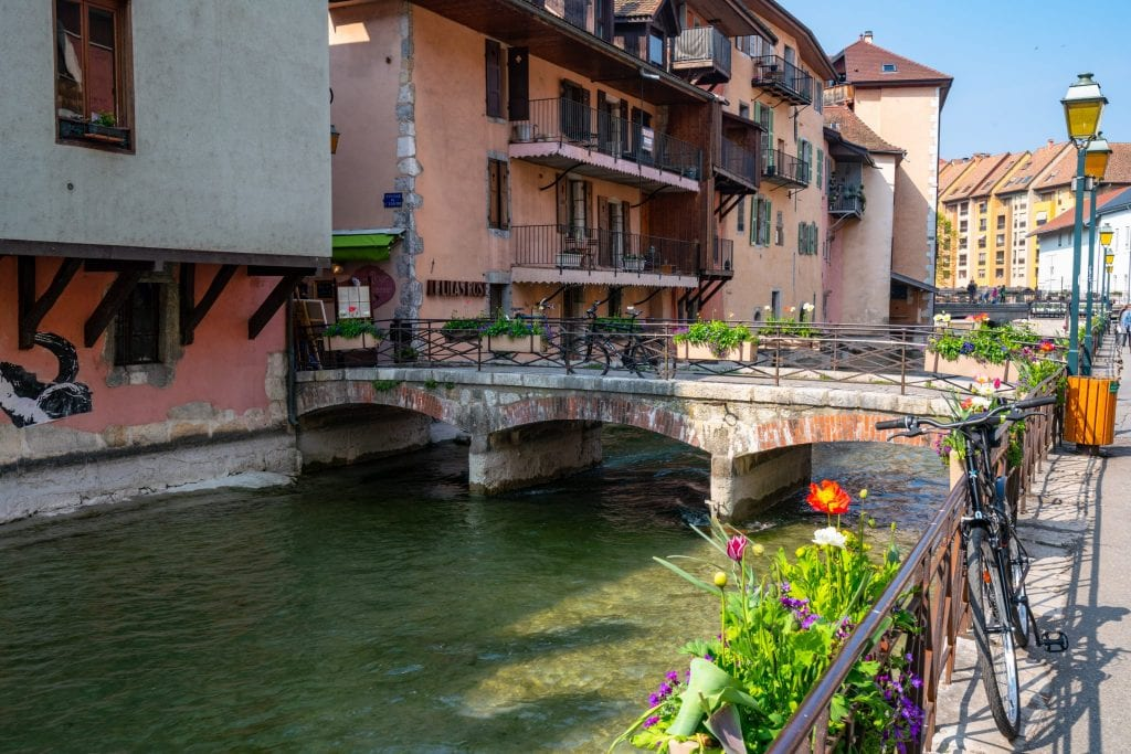 Canal lined with flowers in Annecy, France