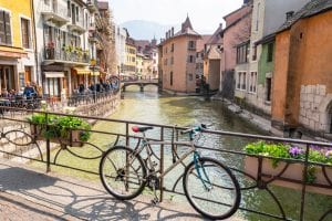 Bike leaning against bridge over a canal in Annecy, France