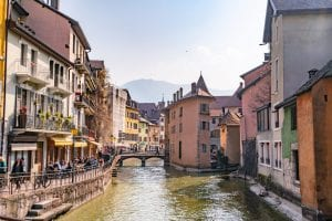 Photo of canal in Annecy France--leaving major cities to see beautiful towns like this is one of our top tips for traveling Europe!