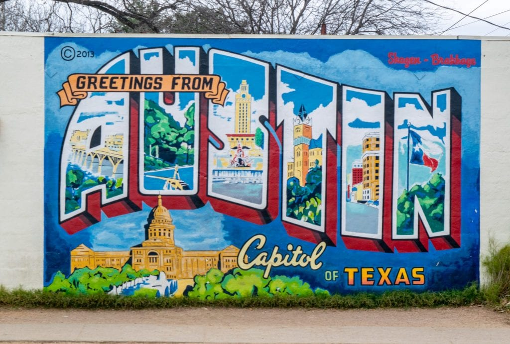 "Close-up photo of blue ""welcome to Austin"" mural in Austin TX"