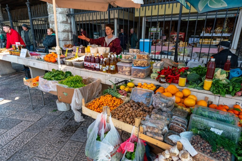 People shopping at Old Town Market, Best Things to Do in Kotor Montenegro