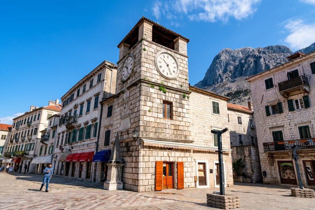 Clock tower in Kotor Montenegro--one of our travel tips for Europe is to get off the beaten path and find less-visited countries like Montenegro to visit!