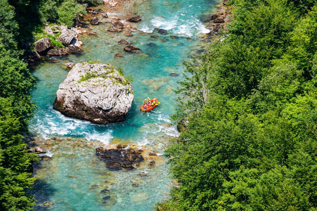 aerial view of orange raft in tara river canyon montenegro