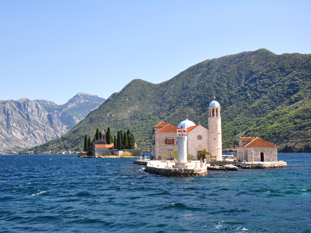view of our lady of the rocks from across the bay in montenegro