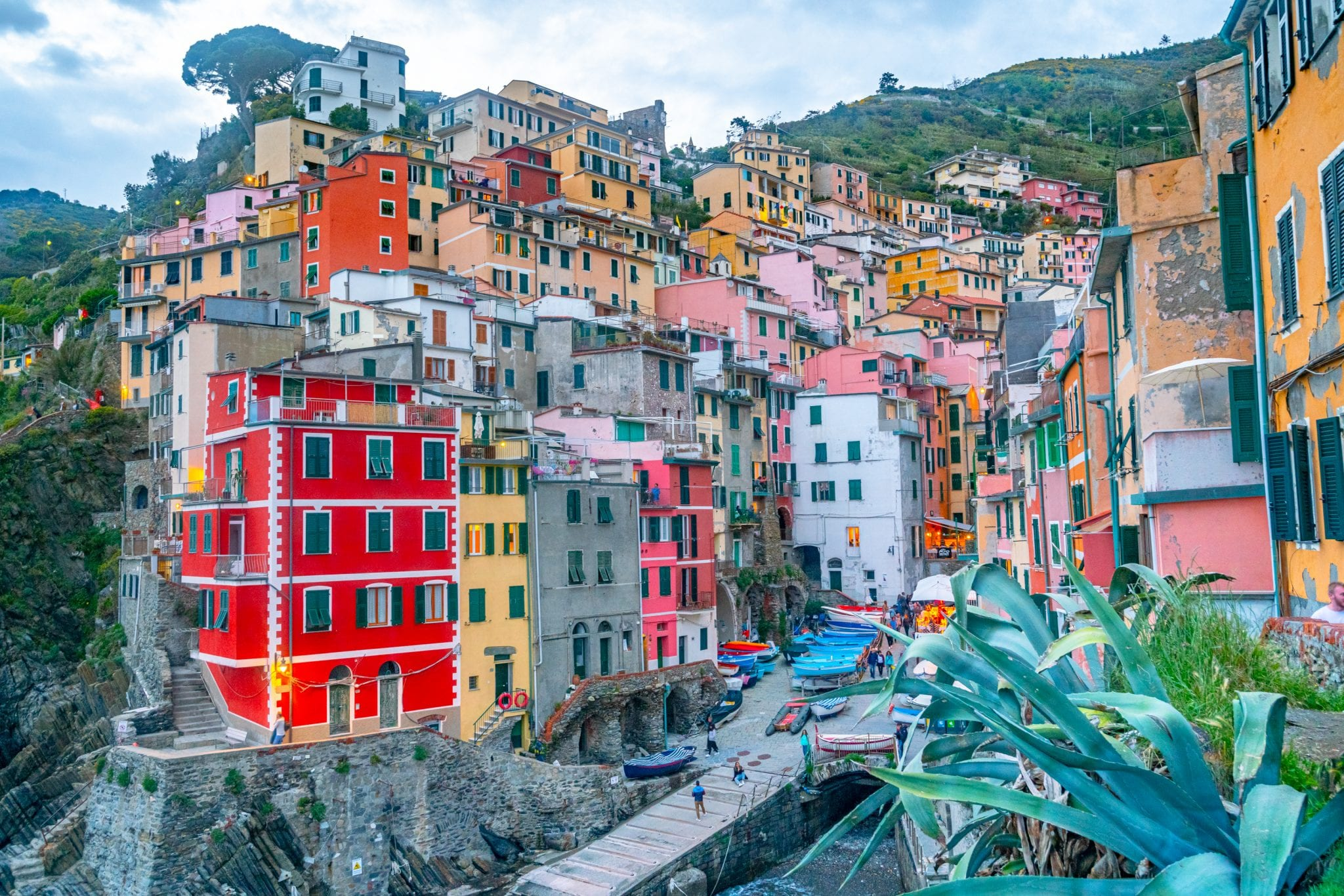 Riomaggiore at sunset from viewpoint above the town, Cinque Terre: visiting here if at all possible is definitely among our best travel tips for Italy!