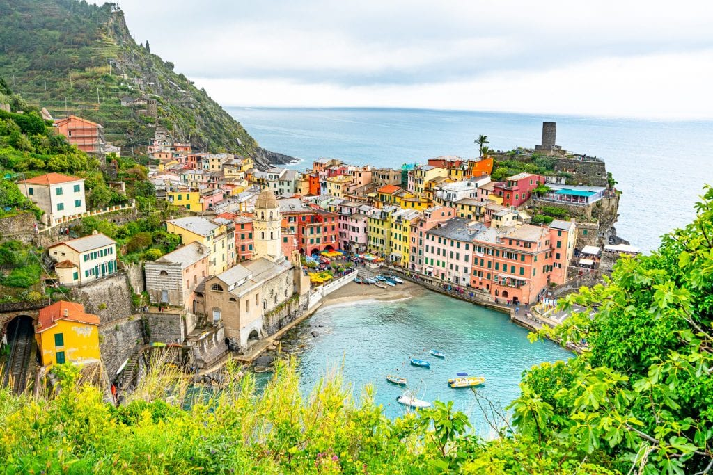 View of Vernazza Harbor in Cinque Terre from hiking trail above: Vernazza is an amazing place to visit during a honeymoon in Italy!