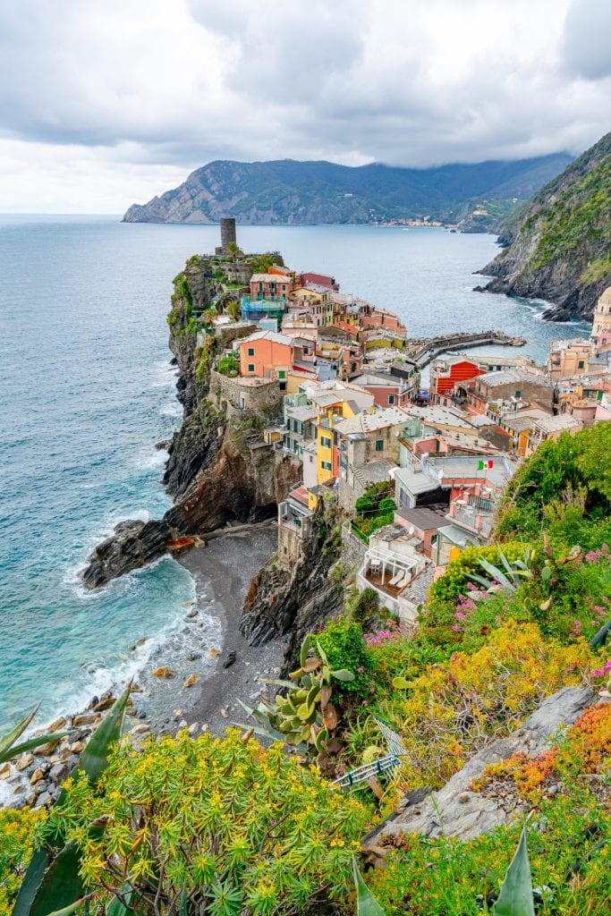 Photo of skyline of Vernazza when approaching from Corniglia: making sure to see this view is one of our Cinque Terre tips!