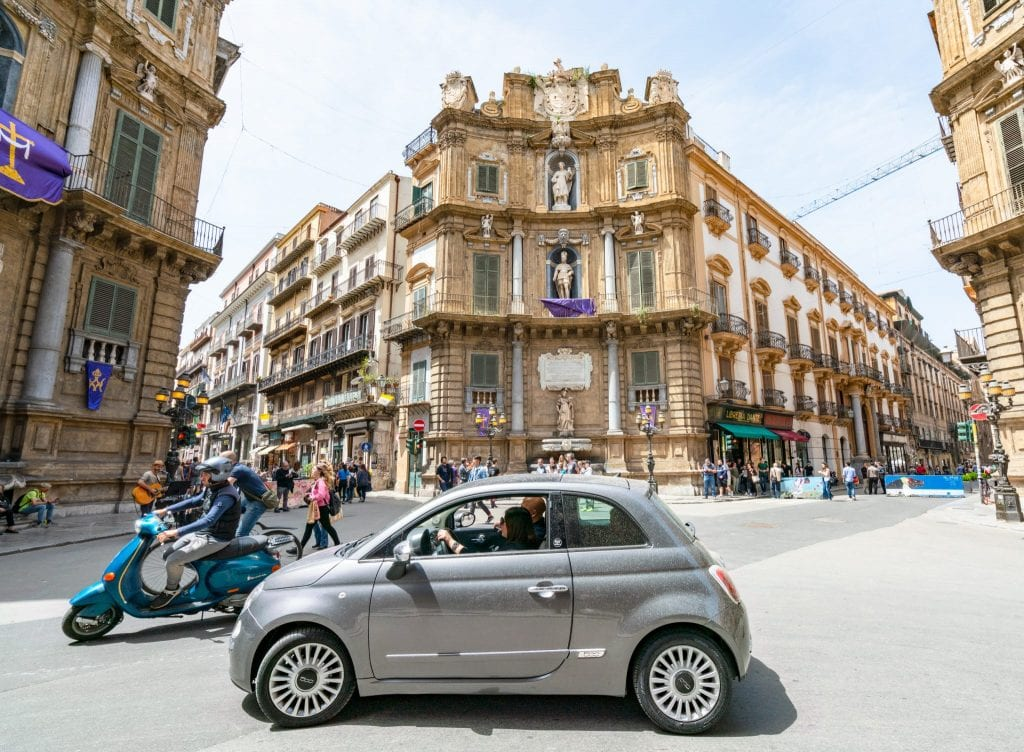 Car and Vespa in Quattro Canti, Palermo