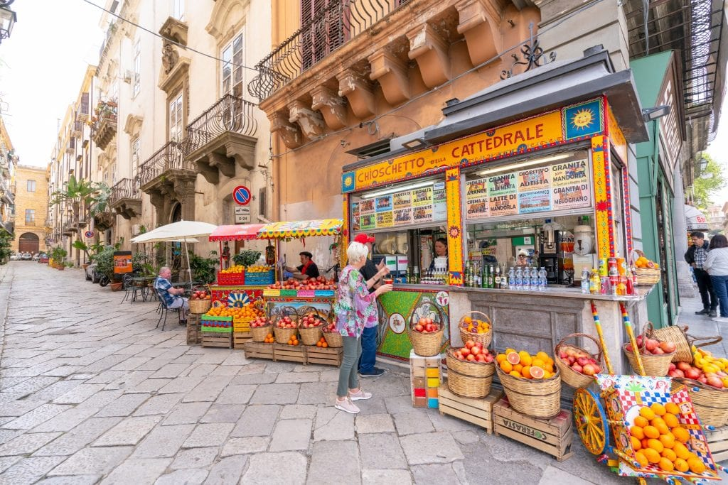 Fruit stand in with piles of oranges in Palermo, Sicily