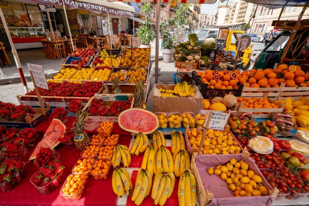 shopping in local markets like this one in palermo belongs on any tips for how to save money to travel the world