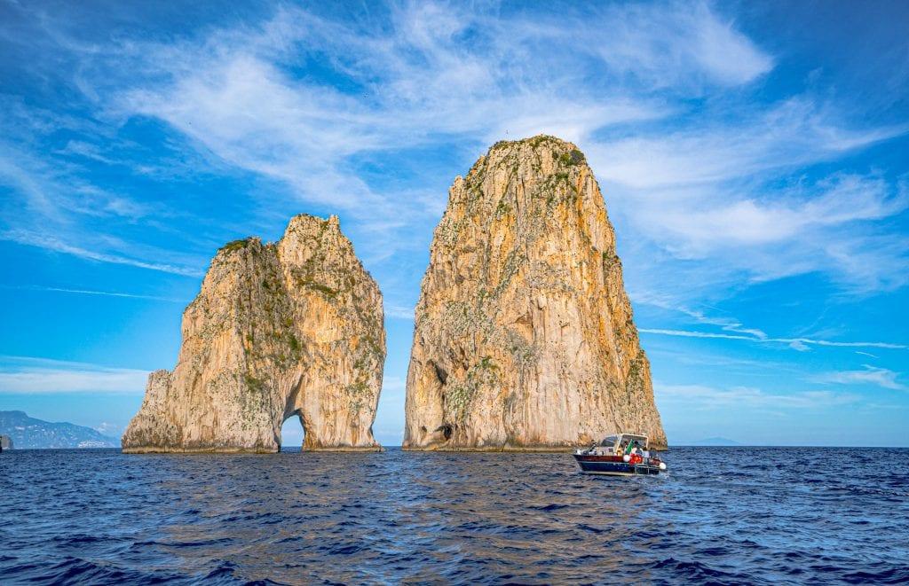 Faraglioni of Capri as seen on a boat tour while visiting the Amalfi Coast area.