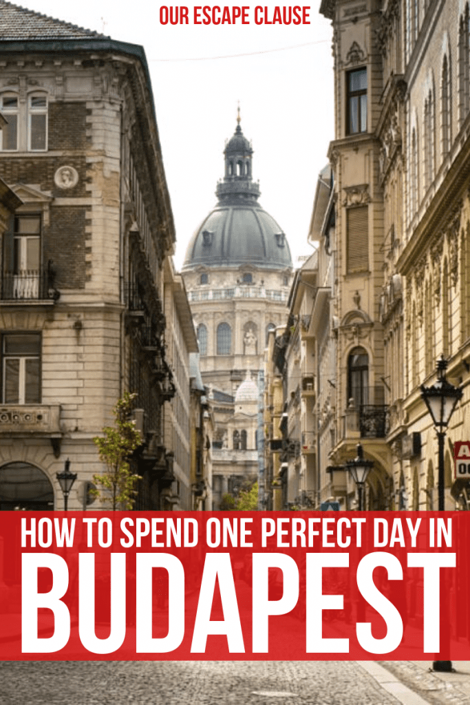 """Photo of street in Budapest that dead-ends into Budapest Opera House. Text on the bottom of the image says """"How to Spend One Perfect Day in Budapest"""", and the text is white on a red background."""