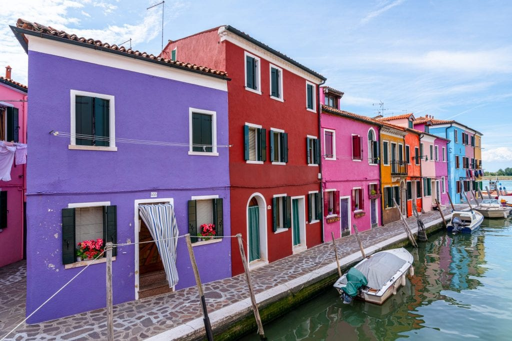 Street in Burano with purple house in foreground.