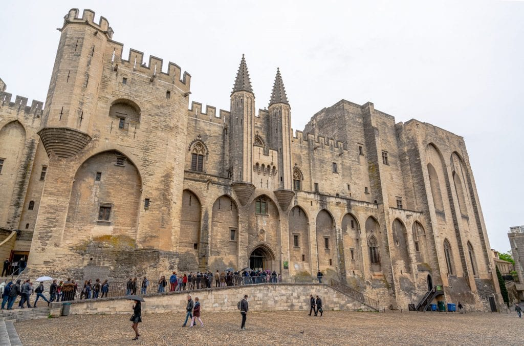 Exterior of the Papal Palace in Avignon France on a cloudy day.