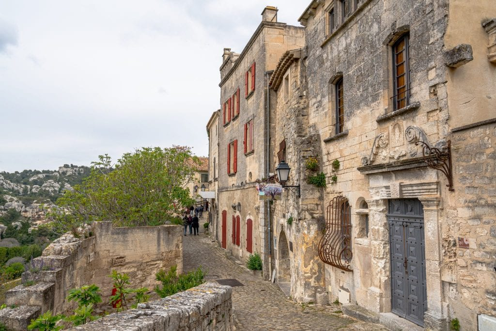 Cobblestone street and stone buildings in Les Baux-de-Provence--don't forget to add this village to your South of France itinerary!