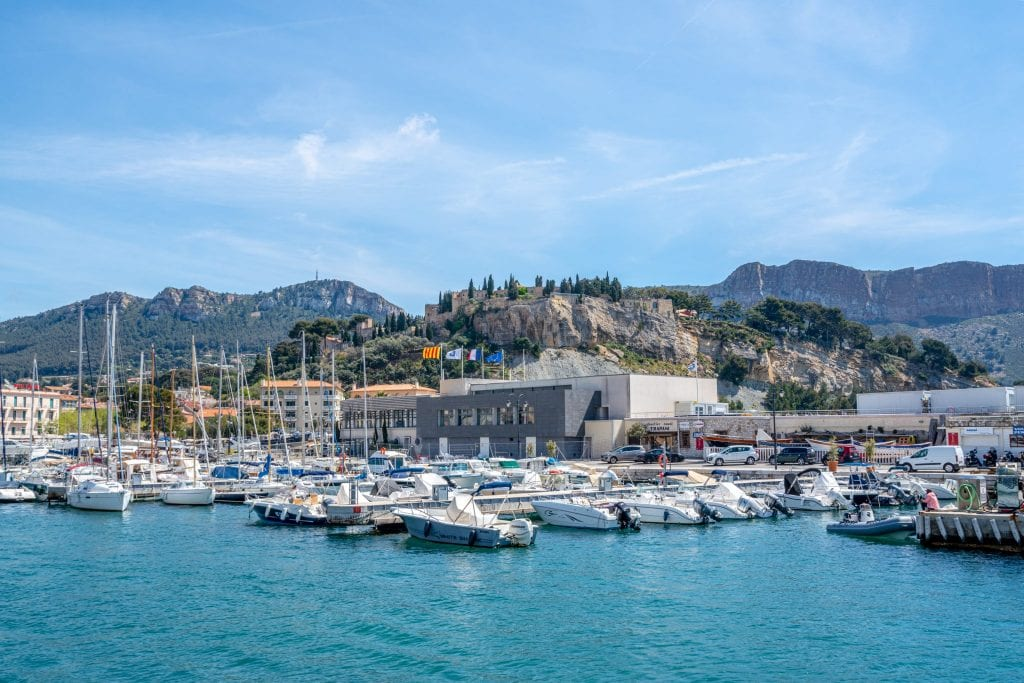 Port de Cassis, Provence, France, with boats tied up to docks and the Chateau de Cassis in the background