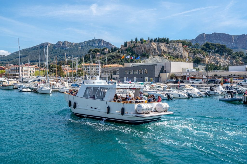 Tour boat driving through Port de Cassis
