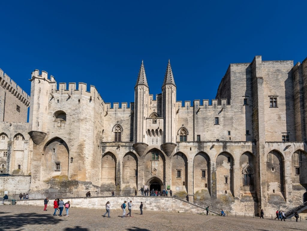 Photo of the exterior of the Papal Palace in Avignon. Don't miss this stop on your south of France itinerary!