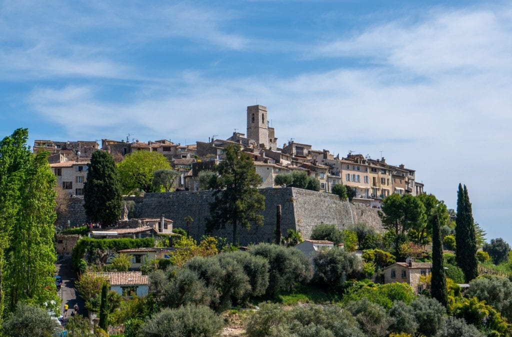 Photo of Saint-Paul-de-Vence France taken from outside the city. You can see the city walls.