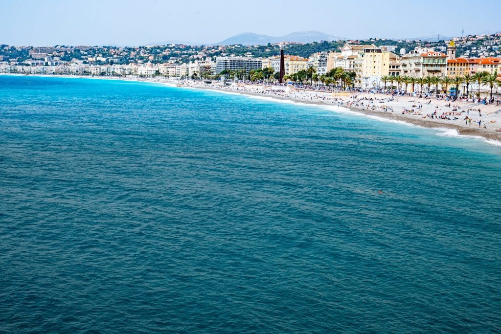 Photo of the curving beach in Nice taken from above during a trip to southern France