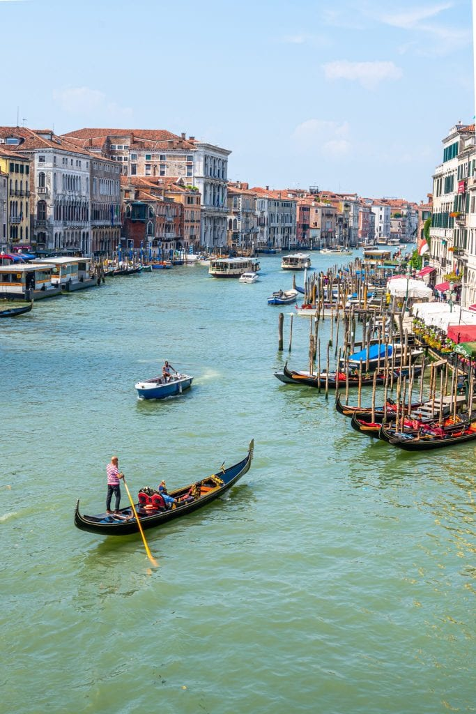 Grand Canal of Venice with a gondola in the center