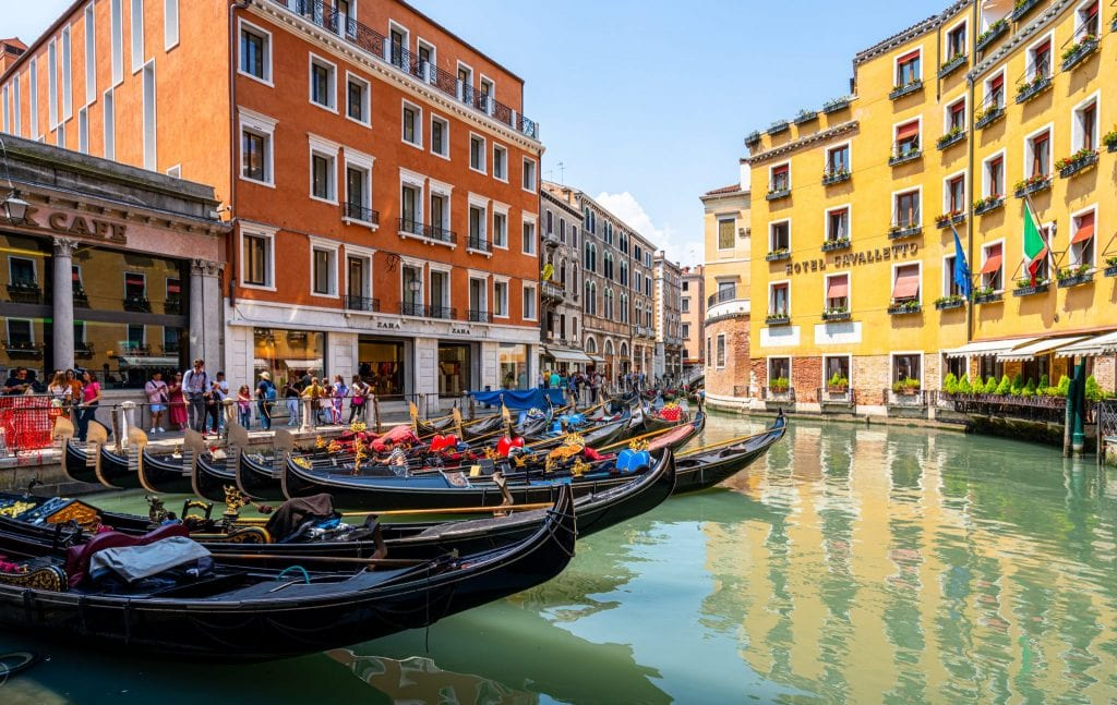 Series of gondolas parked in a canal in Venice--one of the most interesting facts about Italy is that there are far fewer gondolas in the city today than in the past