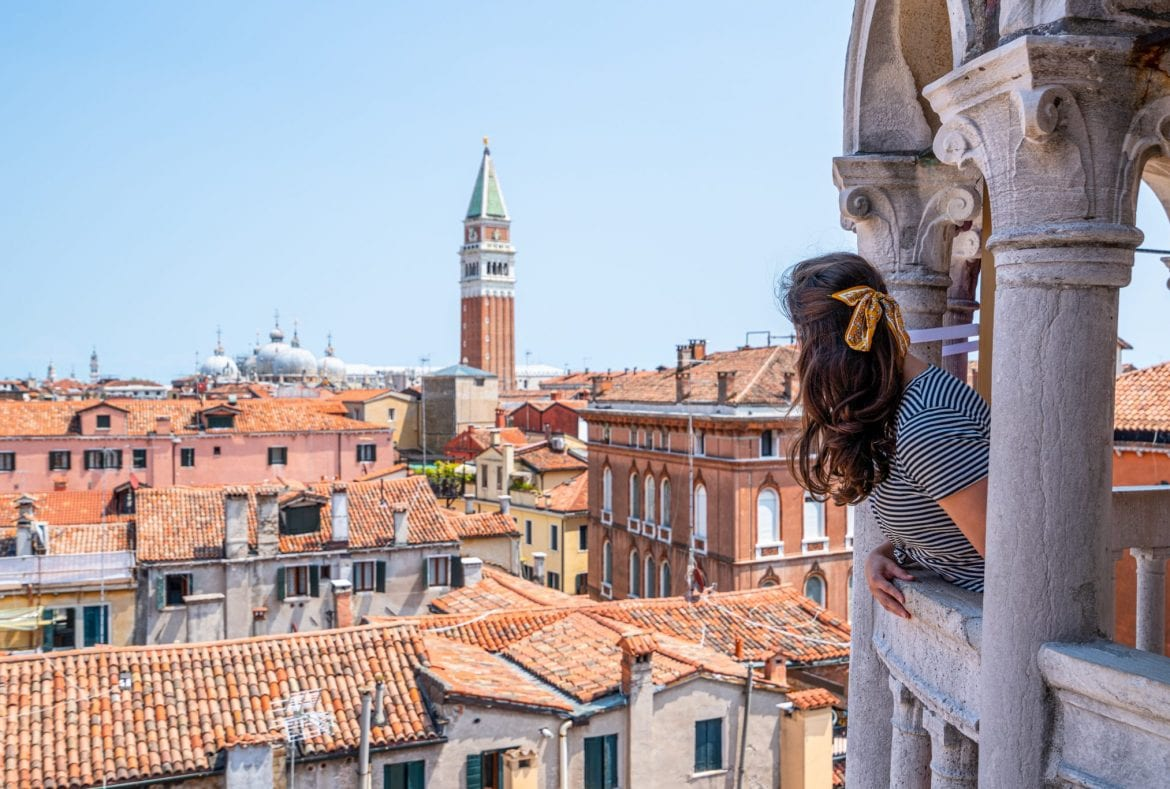 Kate Storm looking toward San Marco Campanile from Scala Contarini del Bovolo, which is an excellent place to visit during 2 days in Venice