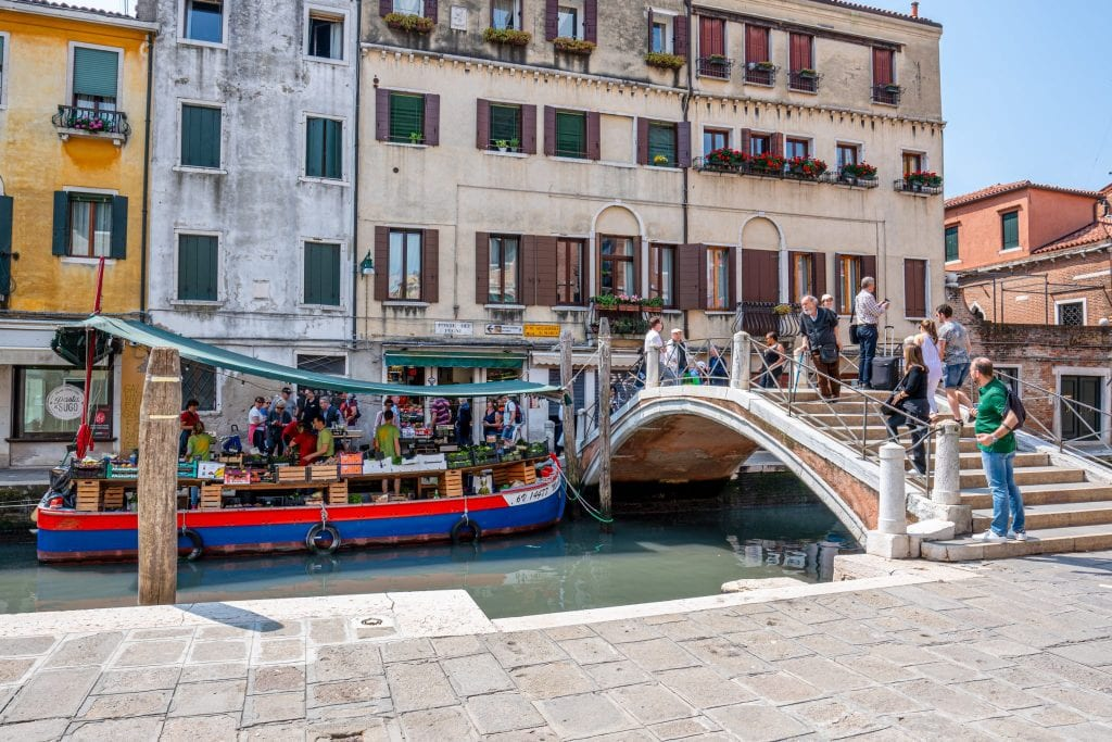Ponte dei Pugni on the right side of the photo in Venice with Dorsoduro vegetable barge visible on the left