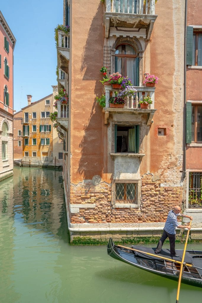 Photo of Venice Canal with a gondolier paddling in the corner