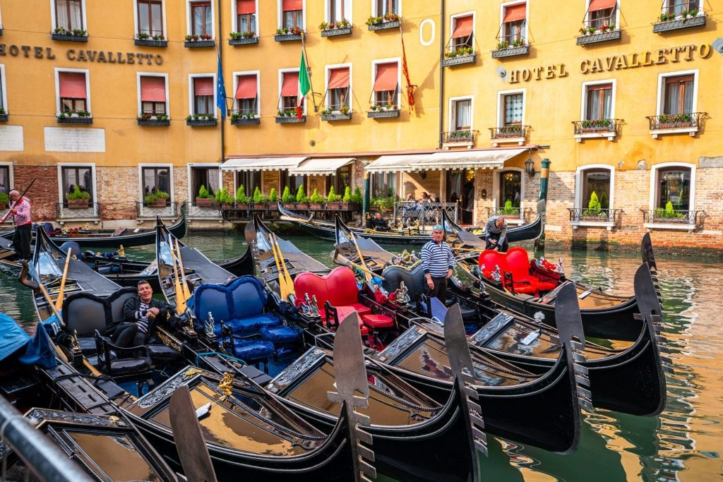 Photo of gondolas parked together near Piazza San Marco in Venice