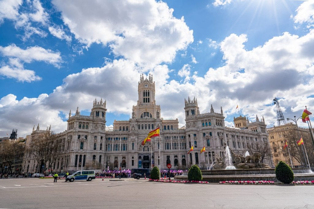 Cybele Palace in Madrid Spain as photographed from across the street. The sky is blue with white clouds. Definitely come by here during your 3 days in Madrid!