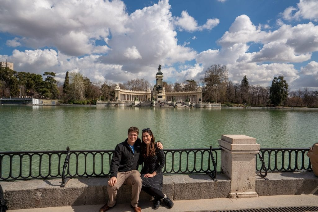 Kate Storm and Jeremy Storm in front of Retiro Park Lake