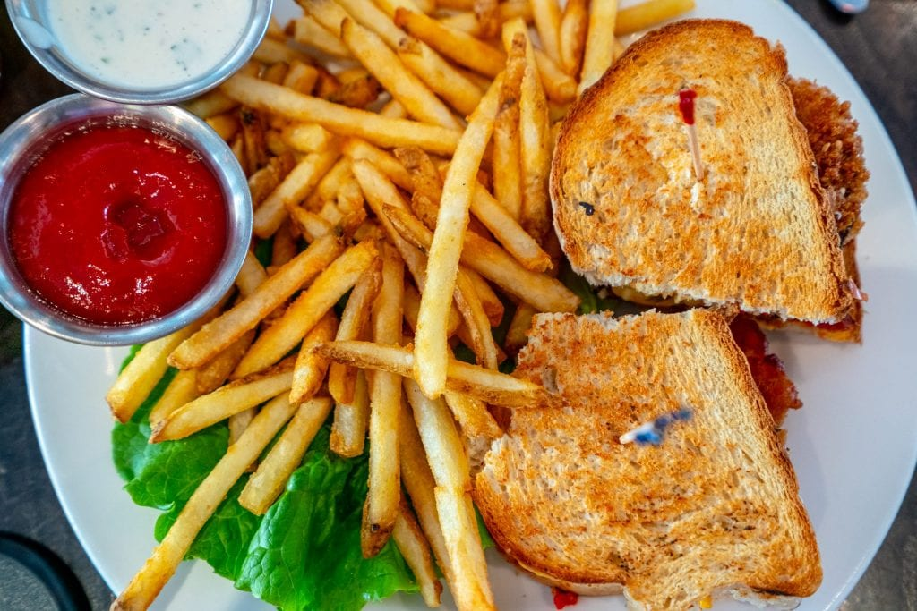 Sandwich and fries shot from above, as served at Front Porch Cafe on Ocean Drive.